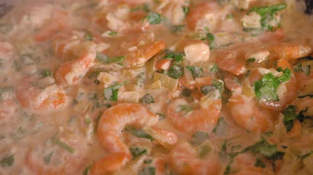 seafood recipe : Cooking shrimp in garlic-cream sauce closeup