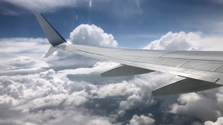 air vehicle : Airplane wing in the clouds. View from the window of the plane Stock Footage