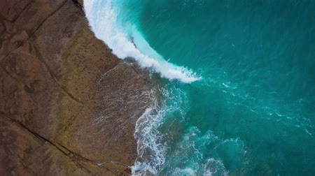 praia : Top view of the desert beach on the Atlantic Ocean. Coast of the island of Tenerife. Aerial drone footage of sea waves reaching shore Vídeos