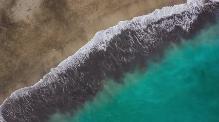 kanári : Top view of the desert beach on the Atlantic Ocean. Coast of the island of Tenerife. Aerial drone footage of sea waves reaching shore Stock mozgókép