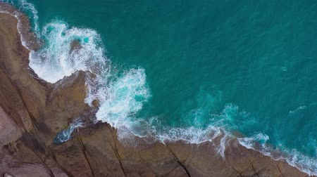 sziget : Top view of the desert beach on the Atlantic Ocean. Coast of the island of Tenerife. Aerial drone footage of sea waves reaching shore Stock mozgókép
