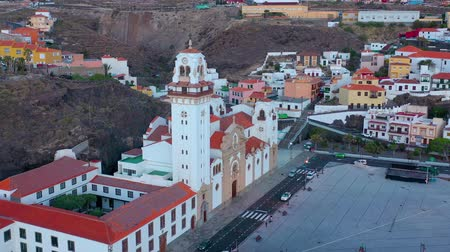 perspektif : Aerial View of Candelaria - City, Atlantic Ocean and Basilica near the capital of the island - Santa Cruz de Tenerife on the Atlantic coast. Tenerife, Canary Islands, Spain Stok Video