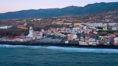 falu : Aerial View of Candelaria - City, Atlantic Ocean and Basilica near the capital of the island - Santa Cruz de Tenerife on the Atlantic coast. Tenerife, Canary Islands, Spain Stock mozgókép