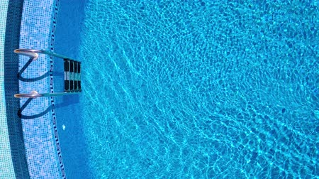 plavat : Topview from a drone over the surface of the pool