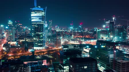semt : Aerial hyperlapse of Warsaw business center at night: skyscrapers and Palace of Science and Culture Stok Video