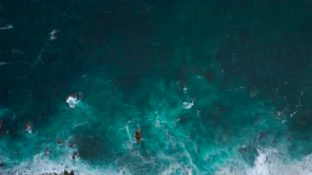 montanhas rochosas : Top view of a deserted coast. Rocky shore of the island of Tenerife. Aerial drone footage of sea waves reaching shore