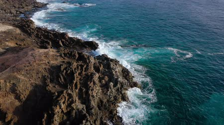 kanári : Top view of a deserted coast. Rocky shore of the island of Tenerife. Aerial drone footage of sea waves reaching shore