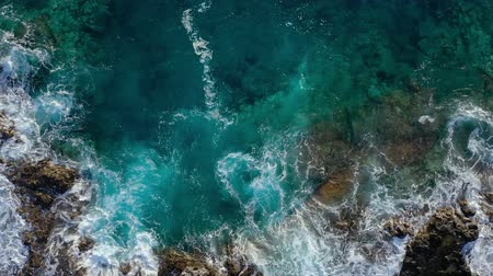 sziget : Top view of a deserted coast. Rocky shore of the island of Tenerife. Aerial drone footage of sea waves reaching shore