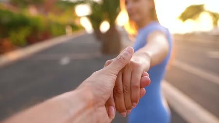 дата : Follow me - woman extends her hand to the man, he takes her hands and gently strokes