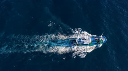 industrial fishing : Top view of a fishing boat sailing in the Atlantic Ocean Stock Footage