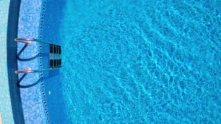 plavat : Top view from a drone over the ladder and surface of the pool