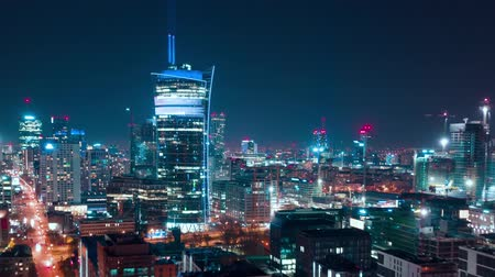 noc : Aerial hyperlapse of Warsaw business center at night: skyscrapers and Palace of Science and Culture Wideo
