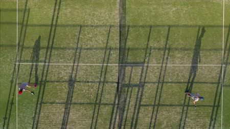 ütő : View from the height of the tennis court where people warm up before the game