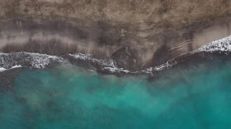 fuzileiros navais : Top view of the desert black beach on the Atlantic Ocean. Coast of the island of Tenerife. Aerial drone footage of sea waves reaching shore