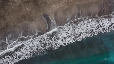 kanári : Top view of the desert black beach on the Atlantic Ocean. Coast of the island of Tenerife. Aerial drone footage of sea waves reaching shore