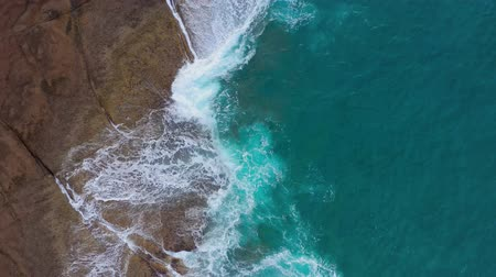 pedras : Top view of the desert stony coast on the Atlantic Ocean. Coast of the island of Tenerife. Aerial drone footage of sea waves reaching shore