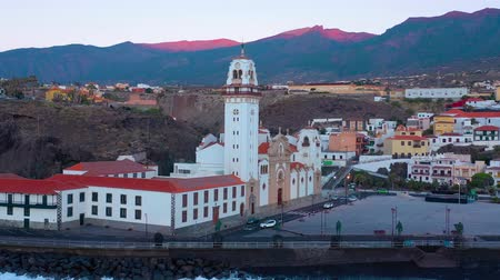 perspektif : View from the height of the Basilica and townscape in Candelaria near the capital of the island - Santa Cruz de Tenerife on the Atlantic coast. Tenerife, Canary Islands, Spain Stok Video