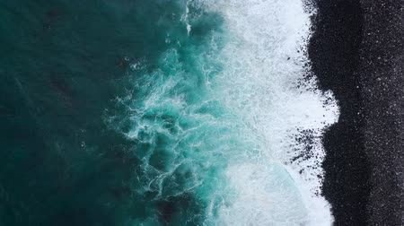 mavi arka : Top view of the desert black beach on the Atlantic Ocean. Coast of the island of Tenerife. Aerial drone footage of sea waves reaching shore