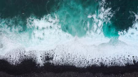 calme : Top view of the desert black beach on the Atlantic Ocean. Coast of the island of Tenerife. Aerial drone footage of sea waves reaching shore