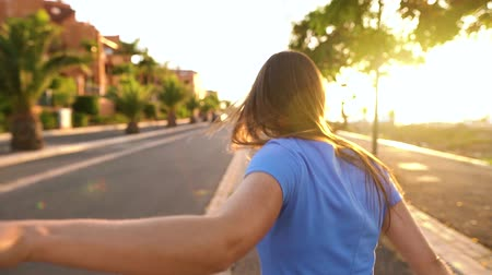 executar : Follow me - happy young woman pulling guys hand - hand in hand running on a bright sunny day. Shooted at different speeds: normal and slow Stock Footage