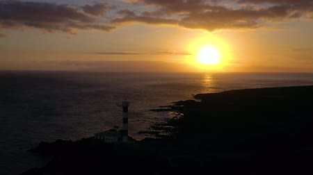 nuvens : View from the height of the lighthouse silhouette Faro de Rasca at sunset on Tenerife, Canary Islands, Spain. Wild Coast of the Atlantic Ocean Vídeos
