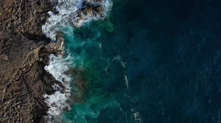 atlantique : Top view of a deserted coast. Rocky shore of the island of Tenerife. Aerial drone footage of sea waves reaching shore