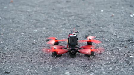air vehicle : Male pilot takeing off FPV freestyle drone in the air