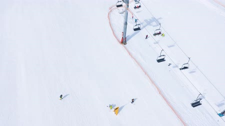 リフト : Aerial hyperlapse of ski slope - ski lift, skiers and snowboarders going down 動画素材
