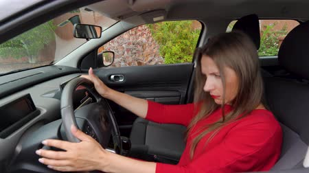 confusão : Woman in red dress is angry and upset, because her car broke down