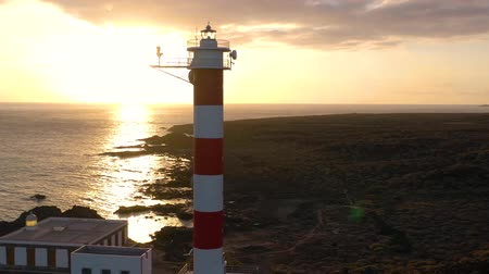 gözlem : View from the height of the lighthouse Faro de Rasca, nature reserve and dark clouds at sunset on Tenerife, Canary Islands, Spain. Wild Coast of the Atlantic Ocean. Accelerated video Stok Video