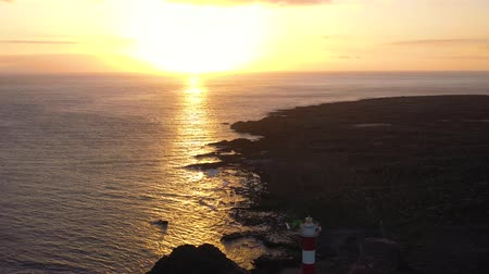 nuvens : View from the height of the lighthouse Faro de Rasca at sunset on Tenerife, Canary Islands, Spain. Wild Coast of the Atlantic Ocean