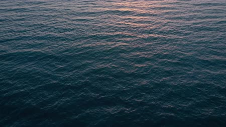 odraz : Aerial view of surface of the Atlantic Ocean on the background of a beautiful sunset