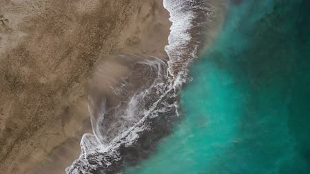 fuzileiros navais : Top view of the desert beach on the Atlantic Ocean. Coast of the island of Tenerife. Aerial drone footage of sea waves reaching shore Vídeos