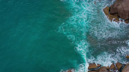 kanarya : Top view of the desert stony coast on the Atlantic Ocean. Coast of the island of Tenerife. Aerial drone footage of sea waves reaching shore