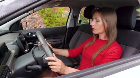 отчаянный : Woman in red dress is angry and upset, because her car broke down