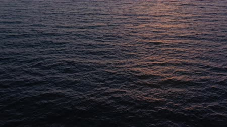 vízfelület : Aerial view of surface of the Atlantic Ocean on the background of a beautiful sunset