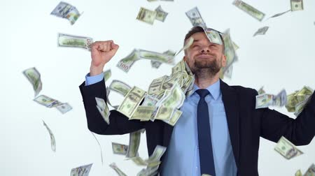 фонд : Slow motion of formally dressed man is delighted with the fact that a lot of dollar bills are fall on him