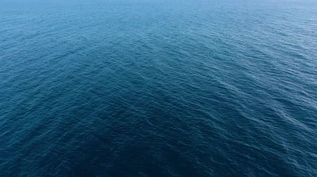 altura : Flying over the blue surface of the sea or ocean Stock Footage