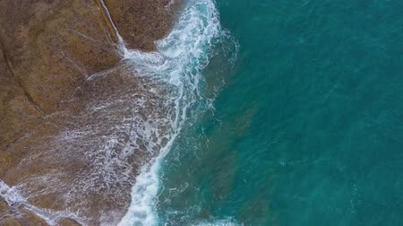 tyrkysový : Top view of the desert stony coast on the Atlantic Ocean. Coast of the island of Tenerife. Aerial drone footage of sea waves reaching shore