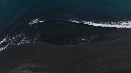 tyrkysový : Top view of the desert black beach on the Atlantic Ocean. Coast of the island of Tenerife. Aerial drone footage of sea waves reaching shore
