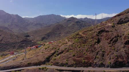 sparse : Aerial view of the mountains, settlement and road. Tenerife, Canary Islands, Spain Stock Footage