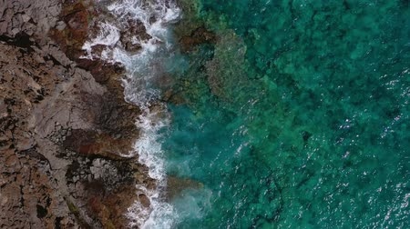 tyrkysový : Top view of a deserted coast. Rocky shore of the island of Tenerife. Aerial drone footage of ocean waves reaching shore