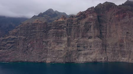 vulcão : Aerial view of Los Gigantes Cliffs on Tenerife overcast, Canary Islands, Spain