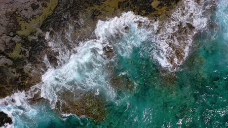 montanhas rochosas : Top view of a deserted coast. Rocky shore of the island of Tenerife. Aerial drone footage of ocean waves reaching shore