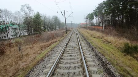 törmelék : FPV drone flight along railway, front view Stock mozgókép