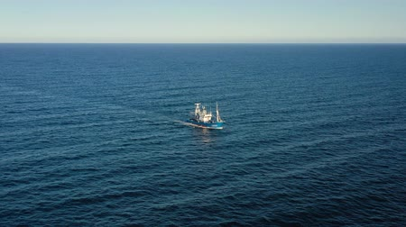 Канарские острова : Birds eye view of a fishing boat sailing in the Atlantic Ocean