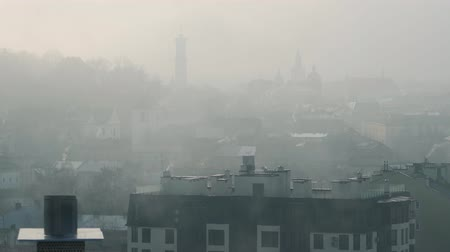 lviv : Historic center of Lviv in dense fog. Silhouettes of buildings and roofs of houses. Ukraine Stock Footage
