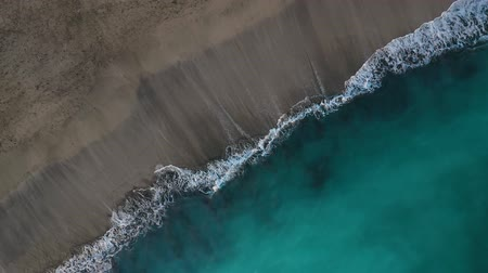 kanarya : Top view of the desert black beach on the Atlantic Ocean. Coast of the island of Tenerife. Aerial drone footage of sea waves reaching shore