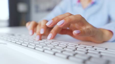 inputting : Female hands typing on a computer keyboard. Concept of remote work.