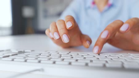 vstup : Female hands typing on a computer keyboard. Concept of remote work.